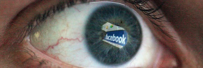 London-england---march-25-in-this-photo-illustration-the-social-networking-site-facebook-is-reflec (1)