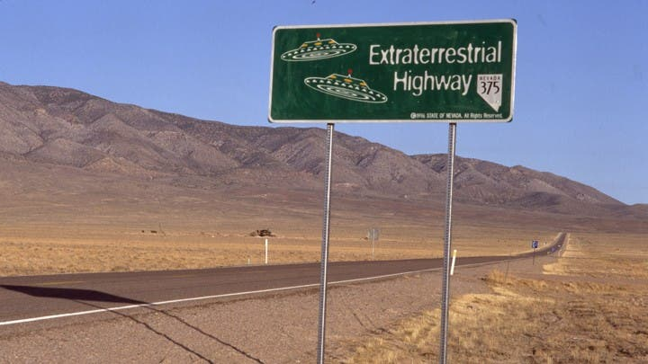 """Extraterrestrial Highway"" Sign on Road"
